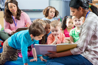 teachers reading to young children