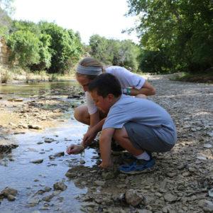 kids exploring a river