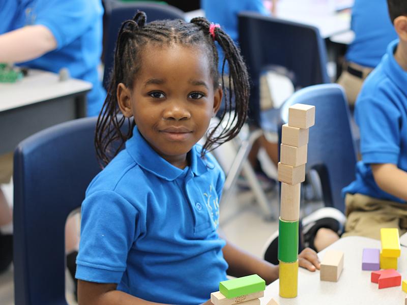 IDEA Achieve girl building blocks