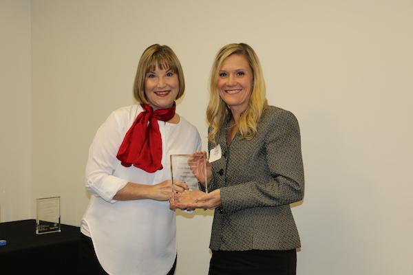 Randi Mitchell receiving Good News Award