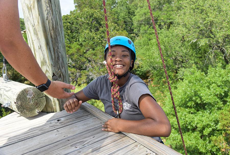 smiling girl climbing