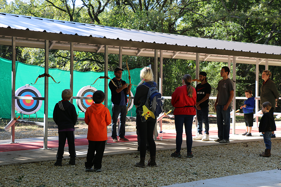 campers getting instruction at archery range