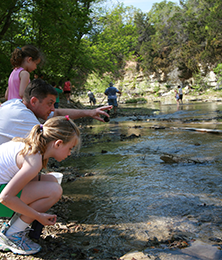 campers exploring Fall Creek at Camp El Tesoro