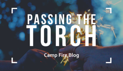 passing the torch, camp fire blog, sparkler in two hands